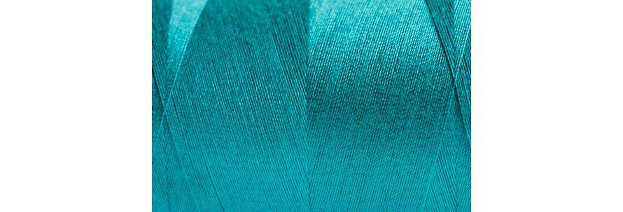 blaues Garn auf Spindel